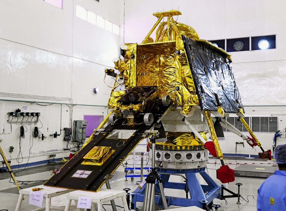 Scientists in Bangalore work on the orbiter vehicle of India's first moon lander and rover mission