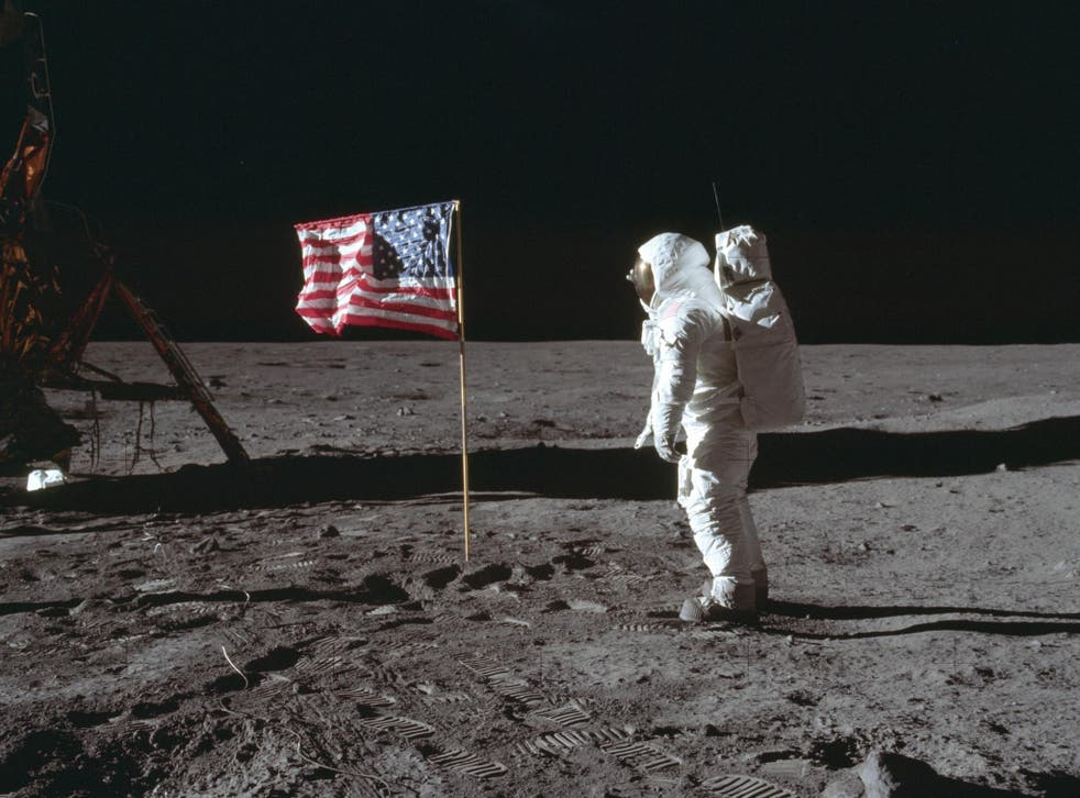 In this July 20, 1969 photo made available by NASA, astronaut Buzz Aldrin Jr. poses for a photograph beside the U.S. flag on the moon during the Apollo 11 mission