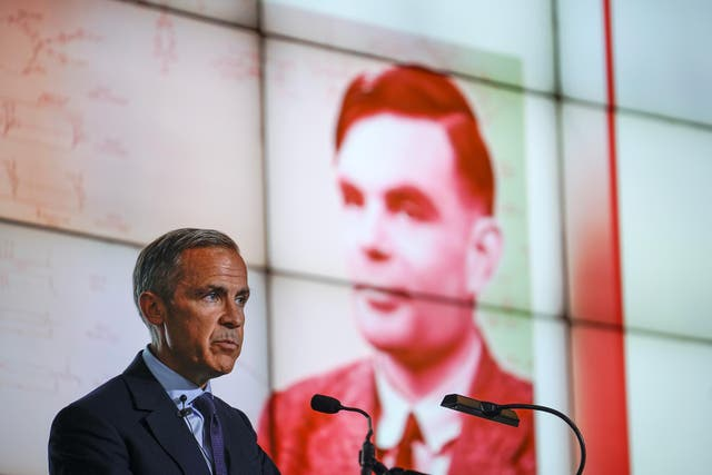 The Governor of the Bank of England, Mark Carney reveals Alan Turing as the new figure to be depicted on the 50 GBP note at the Manchester Science and Industry Museum on July 15, 2019 in Manchester, England