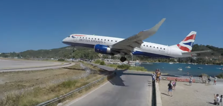 Plane comes in to land just metres from tourists in Greece