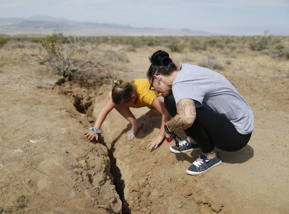 Ridgecrest residents inspect the rupture following two large earthquakes in the area on 7 July