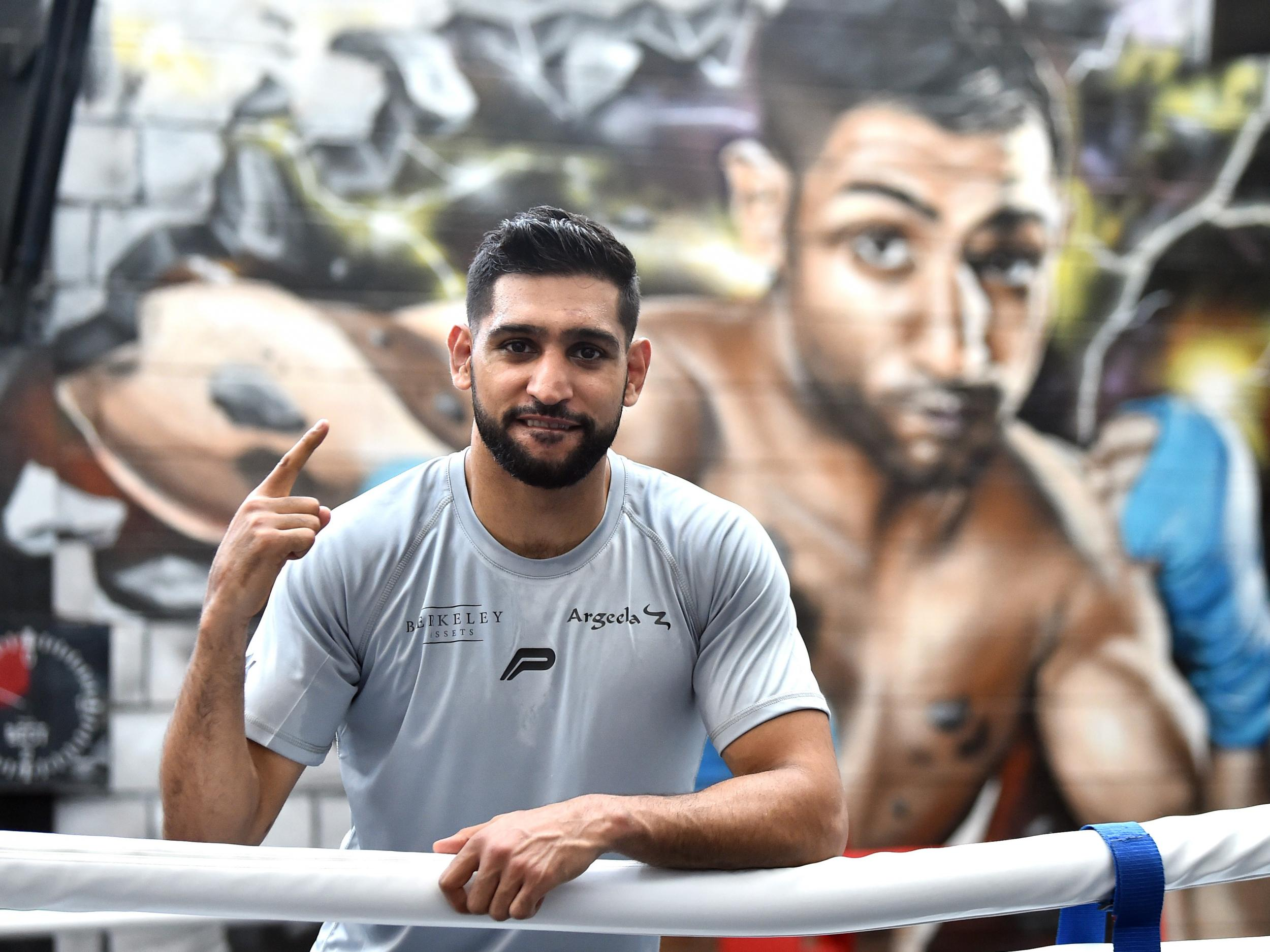 Amir Khan says virus 'man-made' to kill elderly 'while they test 5G'