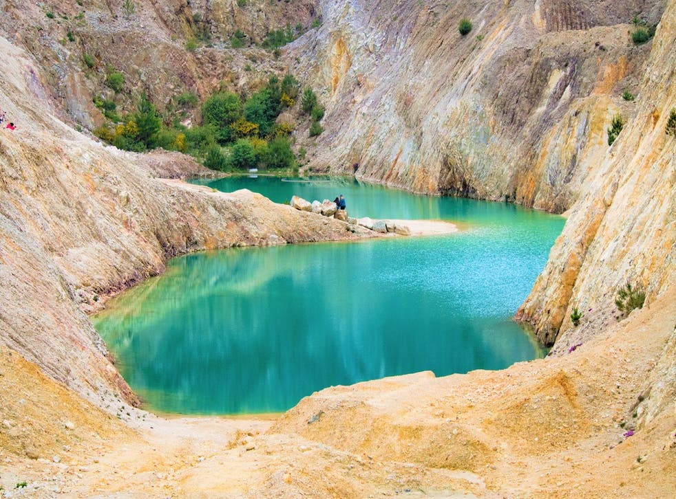 Monte Neme's beautiful blue water is a result of toxic chemicals