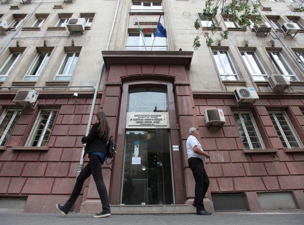 People walk outside Bulgaria's National Revenue Agency building in Sofia