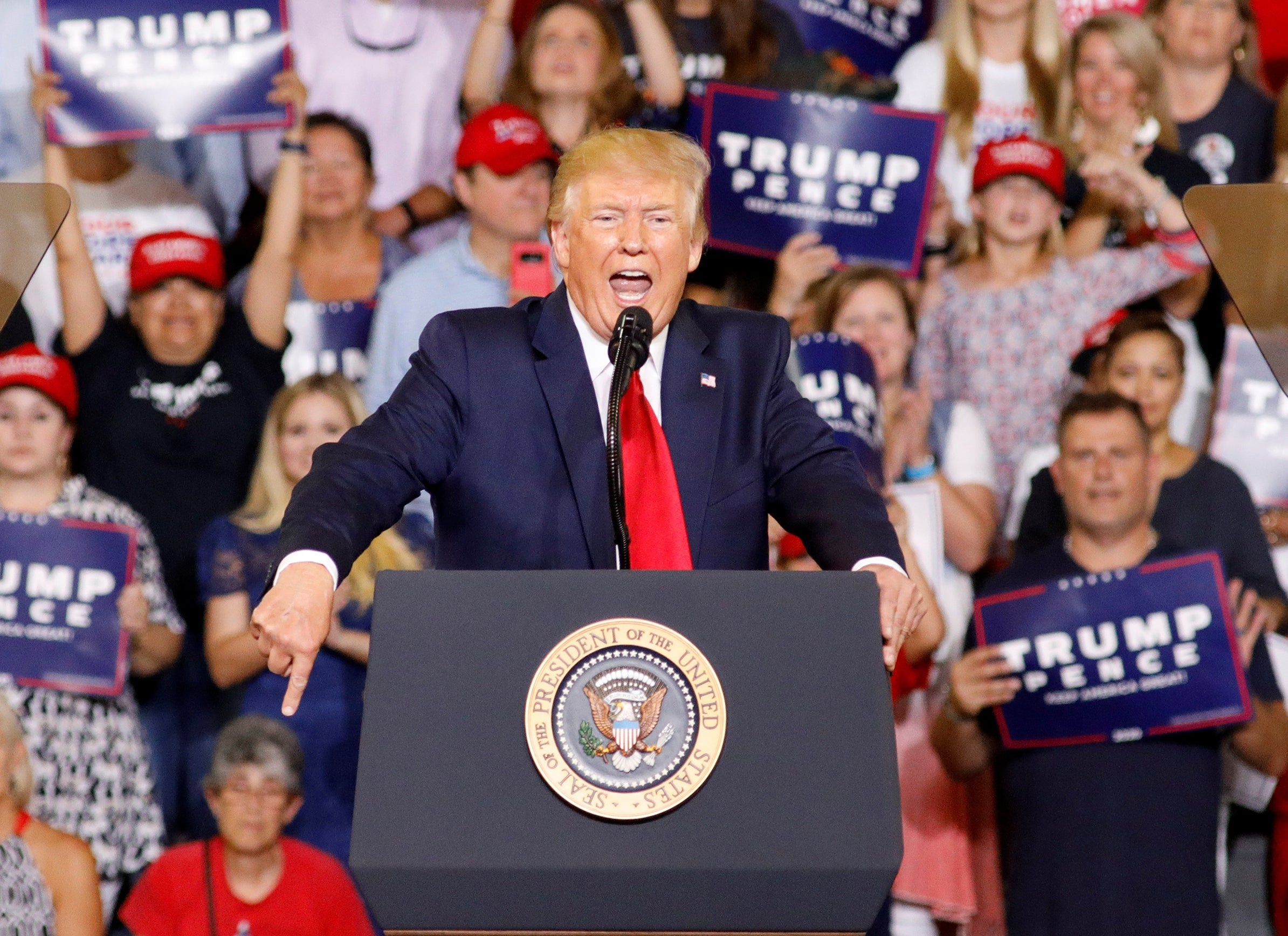 Trump eggs on rally supporters chanting 'send her back' as he steps up racist attack on congresswomen