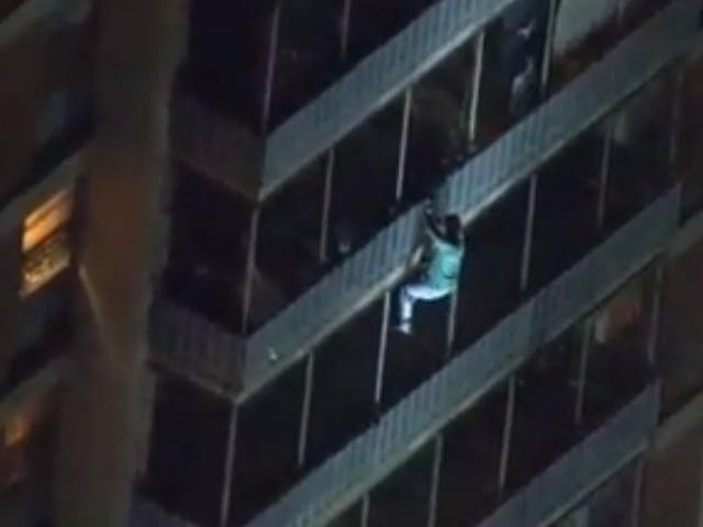 A man scaled down the side of 19-story high rise building to escape from a fire that injured seven
