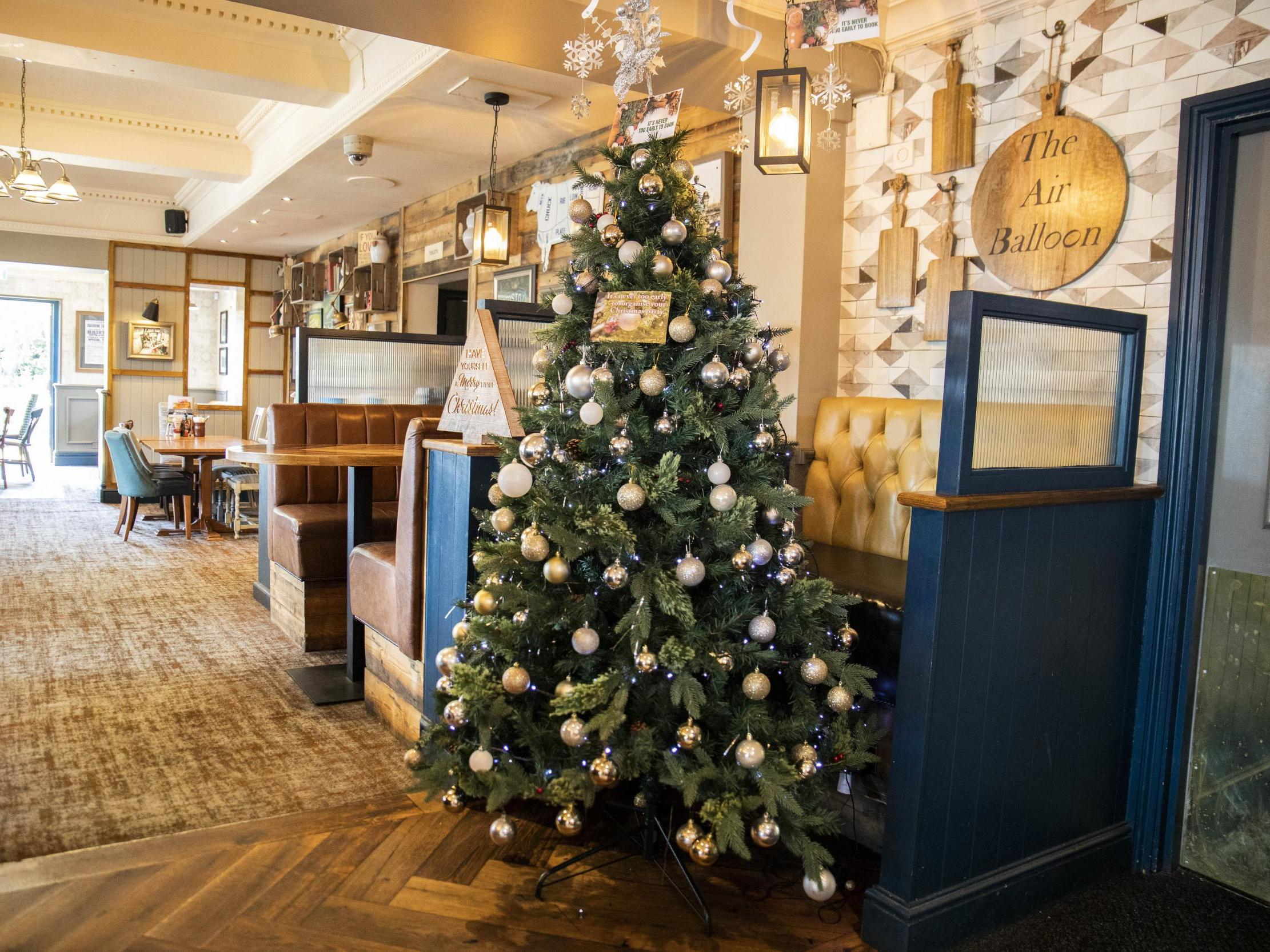 Pub 'becomes first in Britain' to put up Christmas tree in heat of summer