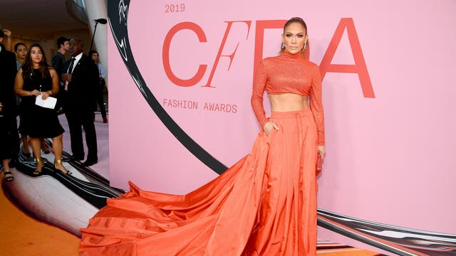 The singer attended the CFDA Fashion Awards at the Brooklyn Museum in June 2019 wearing a bright orange crop top and skirt by Ralph Lauren collection. The outfit reportedly had 43,200 crystals applied to the top, which added extra sparkle to the brightly-hued look.