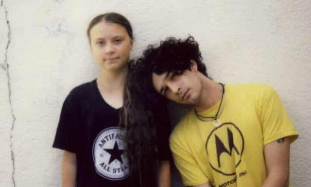 Greta Thunberg, left, with Matty Healy of The 1975