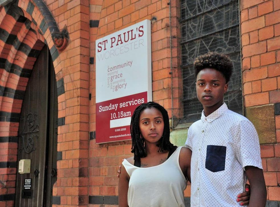 Vanylson Silva, 14, outside St Paul's Church, in Worcester, with his mother Vanessa Santos. Vanylson was arrested by police officers as he entered the church on Sunday, 21 July 2019.