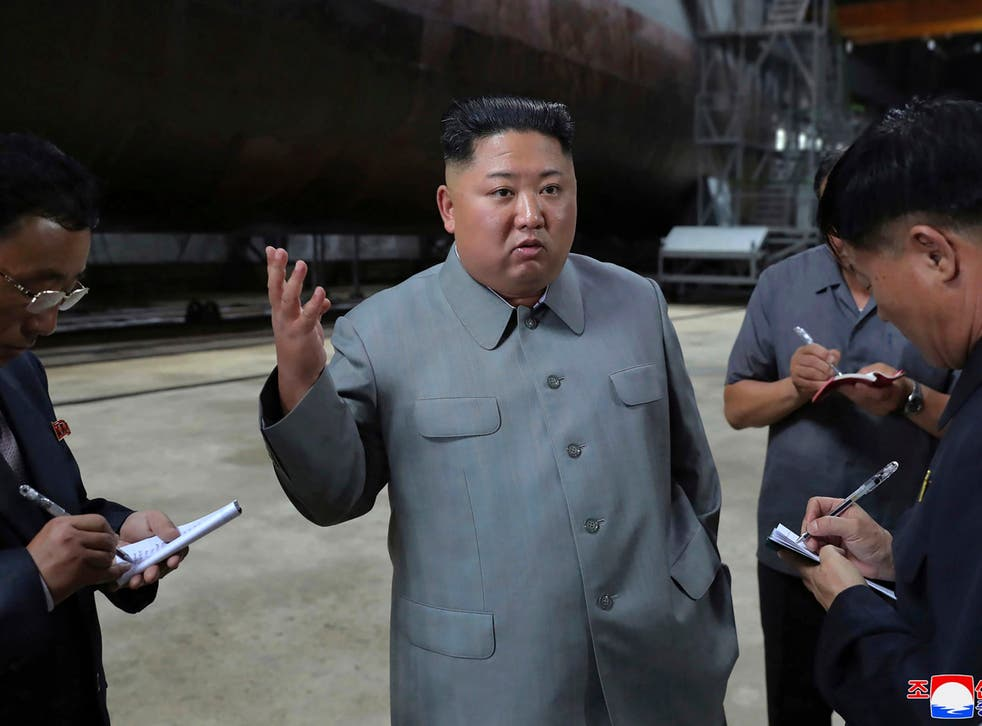Kim Jong-un inspects a new submarine in a photo provided on Tuesday by the North Korean government. North Korea has since tested two short-range ballistic missiles