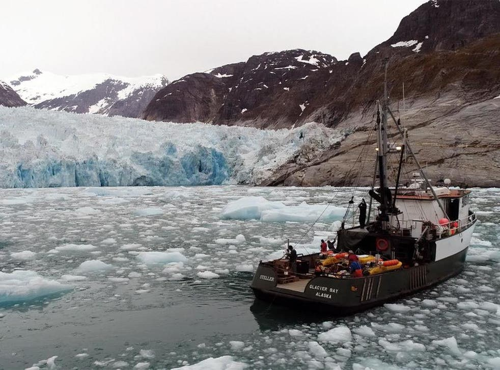 Researchers at Alaska's LeConte Glacier in 2016. A pole holds the sonar instrument that collects data on the subsurface ice