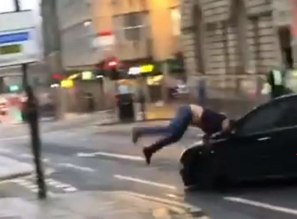 Still image taken from video shared on Facebook of a car appearing to drive at a man, knocking him to the ground in Newcastle city centre on 27 July 2019.