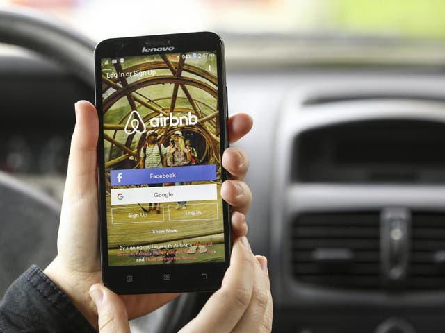 Close-up of a smartphone with the Airbnb app login screen