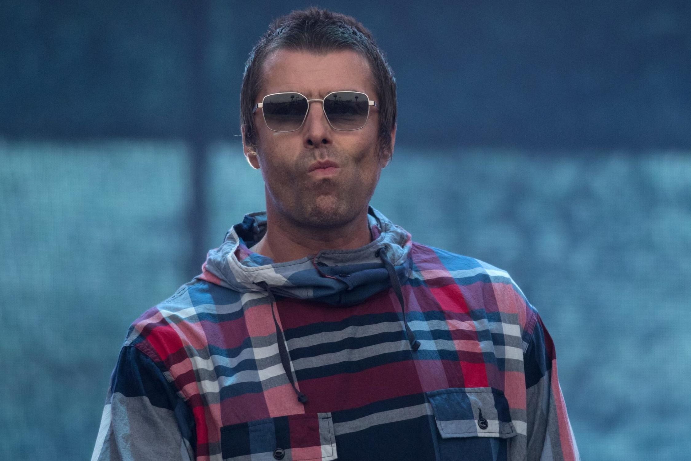 Liam Gallagher changes song lyrics on stage in apparent dig