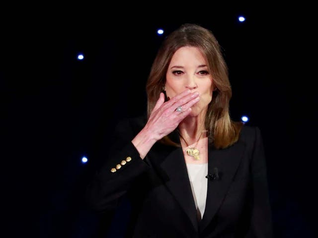 Candidate author Marianne Williamson blows a kiss before the first night of the second 2020 Democratic debate