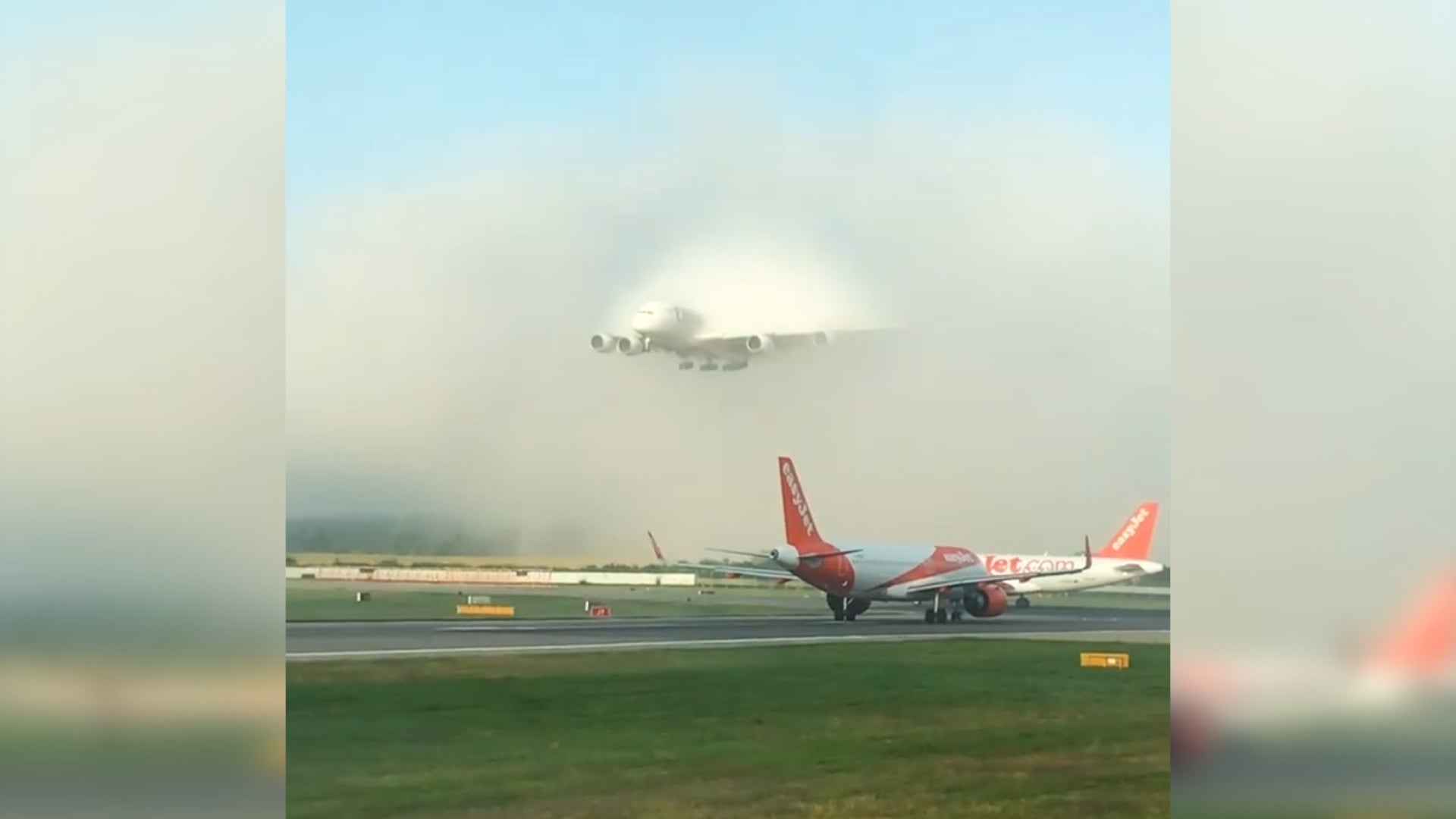 Emirates A380 flies through blanket of fog to land on runway in 'majestic' footage