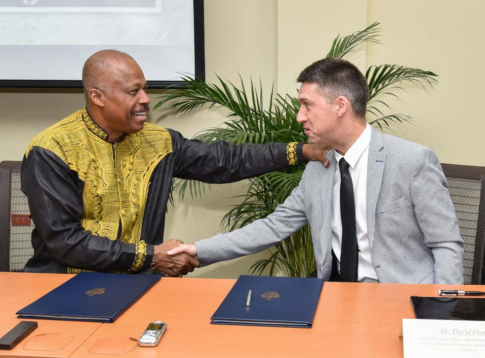 Reparations agreement: Professor Sir Hilary Beckles of the University of the West Indies, left, shakes hands with Dr David Duncan of the University of Glasgow