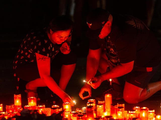 People light candles during an anti-government demonstration in Bucharest, Romania on 27 July 2019.