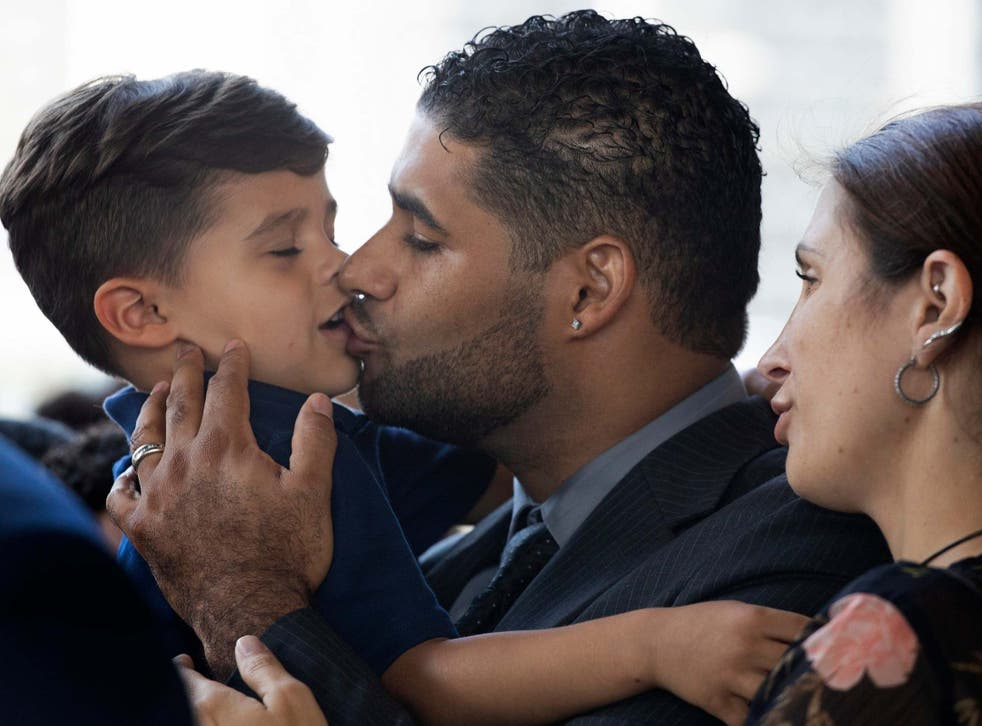 Juan Rodriguez with his son Tristan and wife Marissa at Bronx Criminal Court
