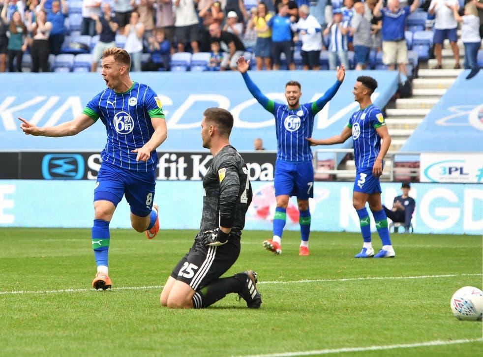 Wigan celebrate their third goal