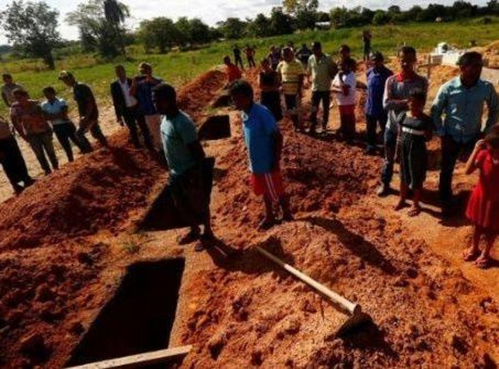 The funeral of 10 land activists killed in 2017 when police arrived at a Santa Lucia farm in Pau D'Arco, Brazil