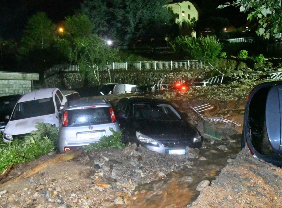 Wrecked vehicles in Casargo, Lecco, Italy, on 7 August