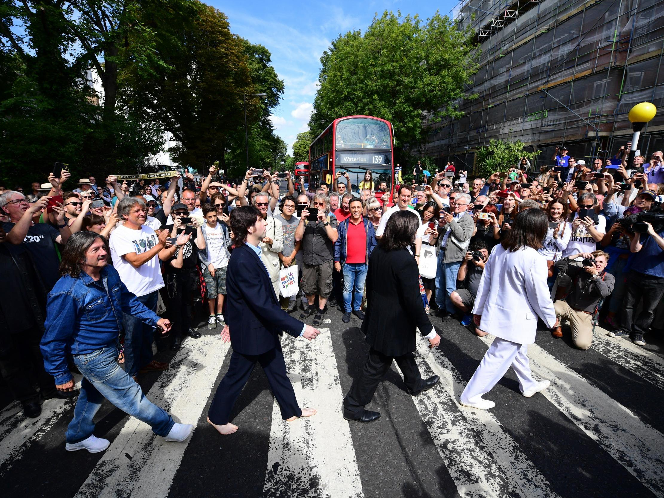 Beatles fans gather to celebrate 50 years since band were photographed on Abbey Road