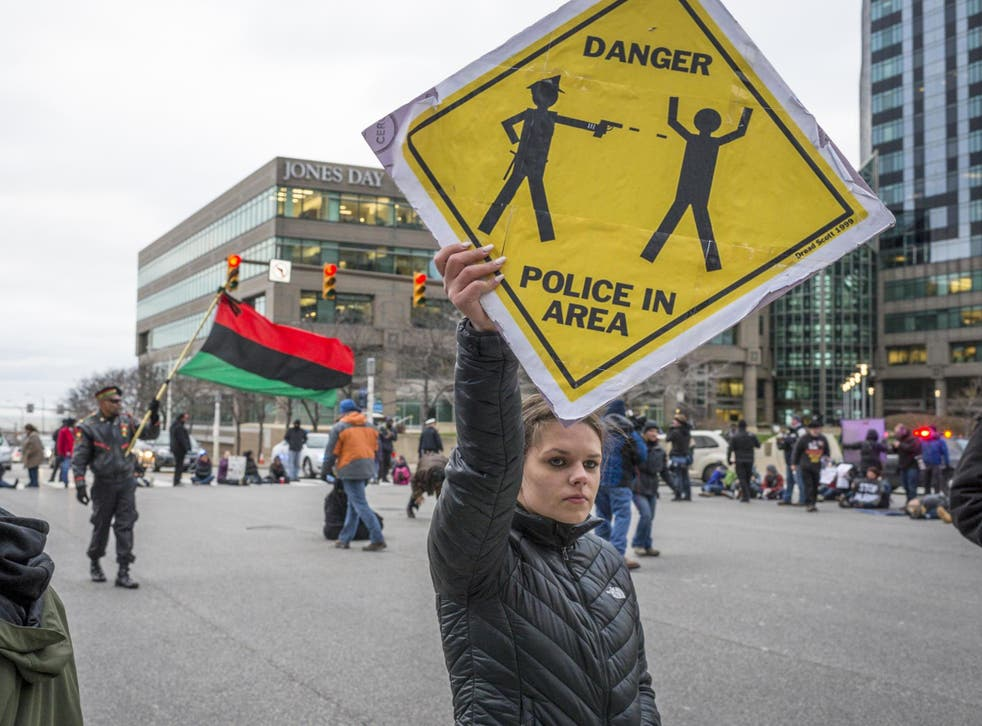 Protesters on the street the day after a grand jury declined to indict Cleveland Police officer Timothy Loehmann for the fatal shooting of Tamir Rice on 22 November 2014.