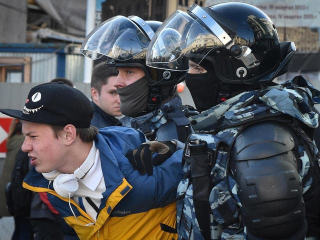 Russian special police forces detain a protester after a rally in Moscow urging fair elections