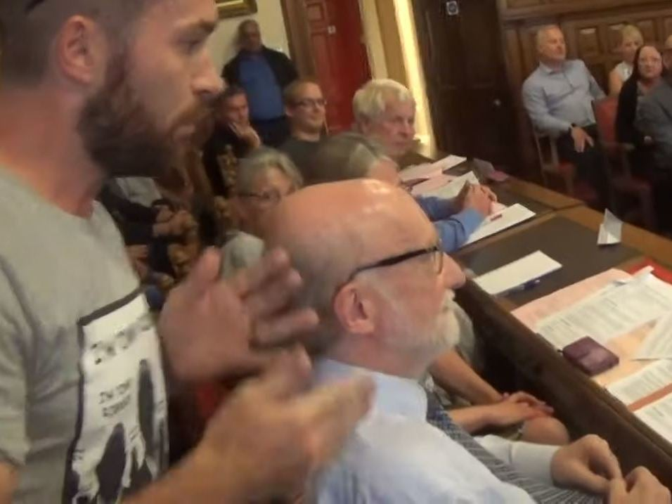 Liberal Democrat peer calls protester in Tommy Robinson shirt a 'Nazi' over mosque row