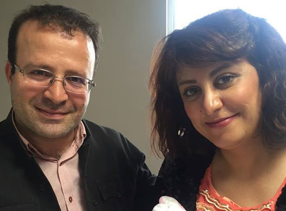 Kameel Ahmady, pictured with his wife, was arrested at the couple's home in western Iran on Sunday