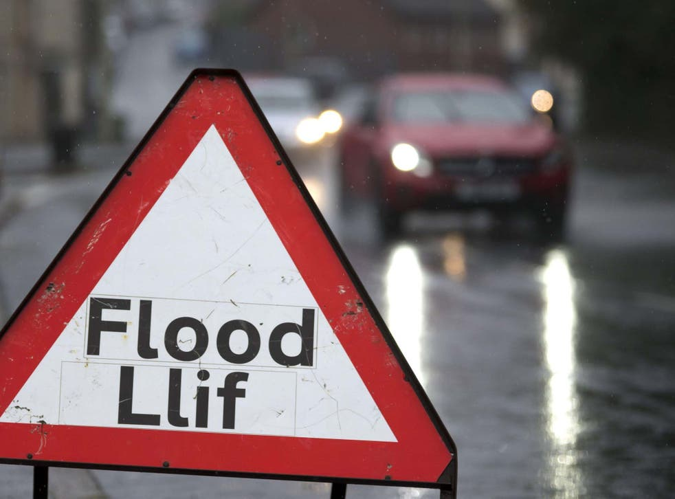Flood warning signs were put out in Pontypridd, Wales, after the Met Office issued a yellow weather warning
