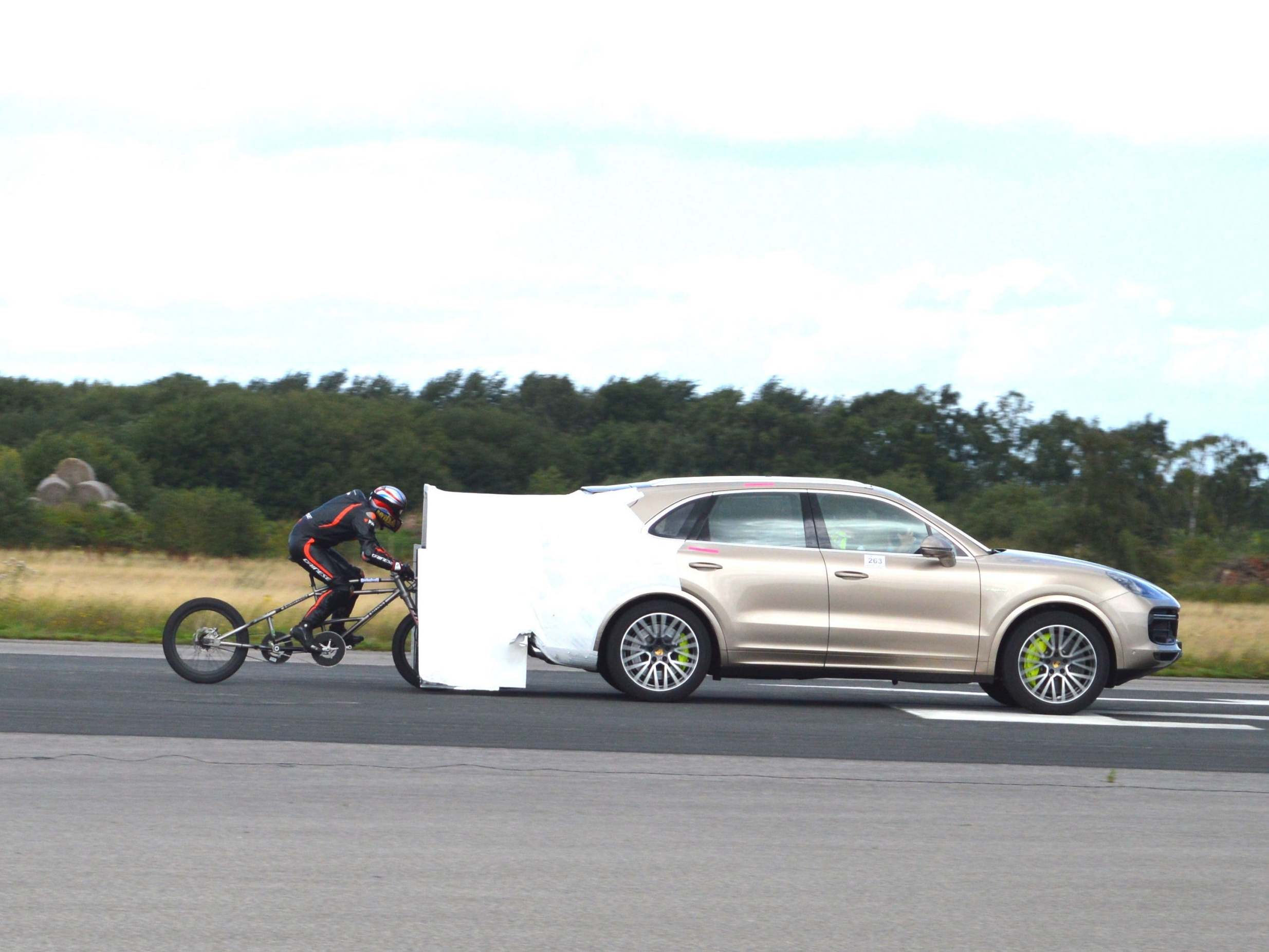 Man goes 174mph on bike in new cycling speed record