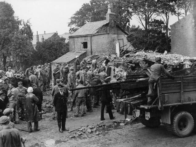 American airmen and villagers desperately search for survivors after the accident