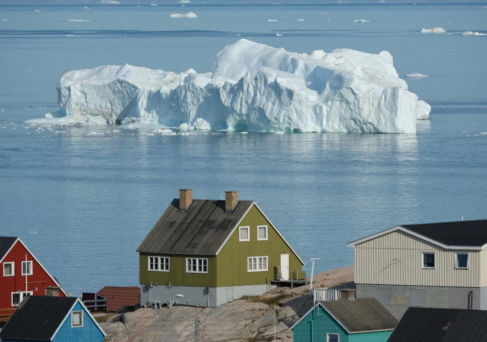 An iceberg floats by in Greenland, where the rate of glacier retreat has accelerated over the past several decades