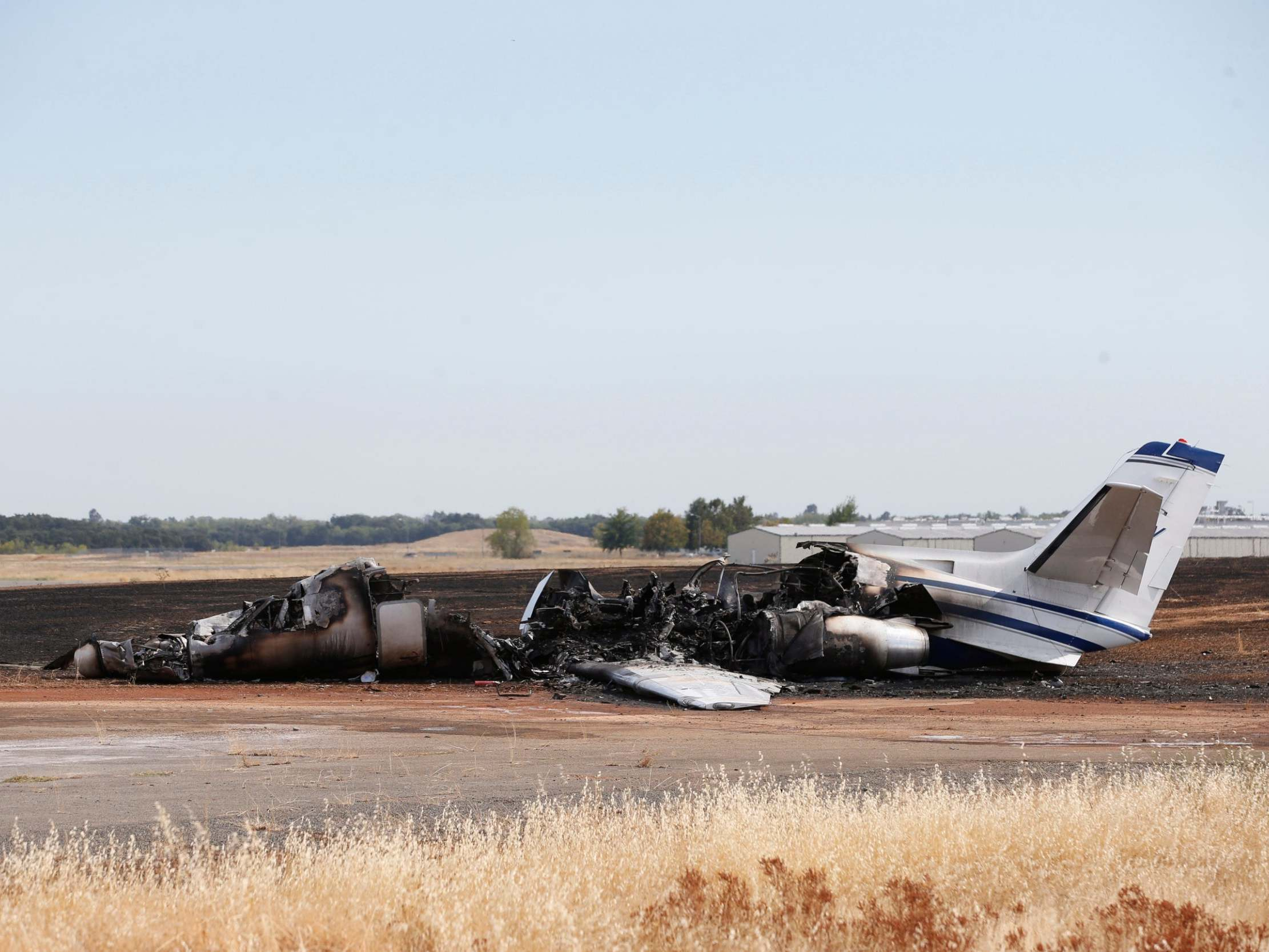 Plane bursts into flames after aborted take-off at California airport
