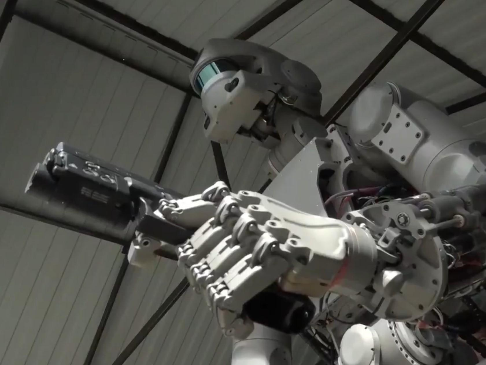 Gun-toting humanoid robot sent into space