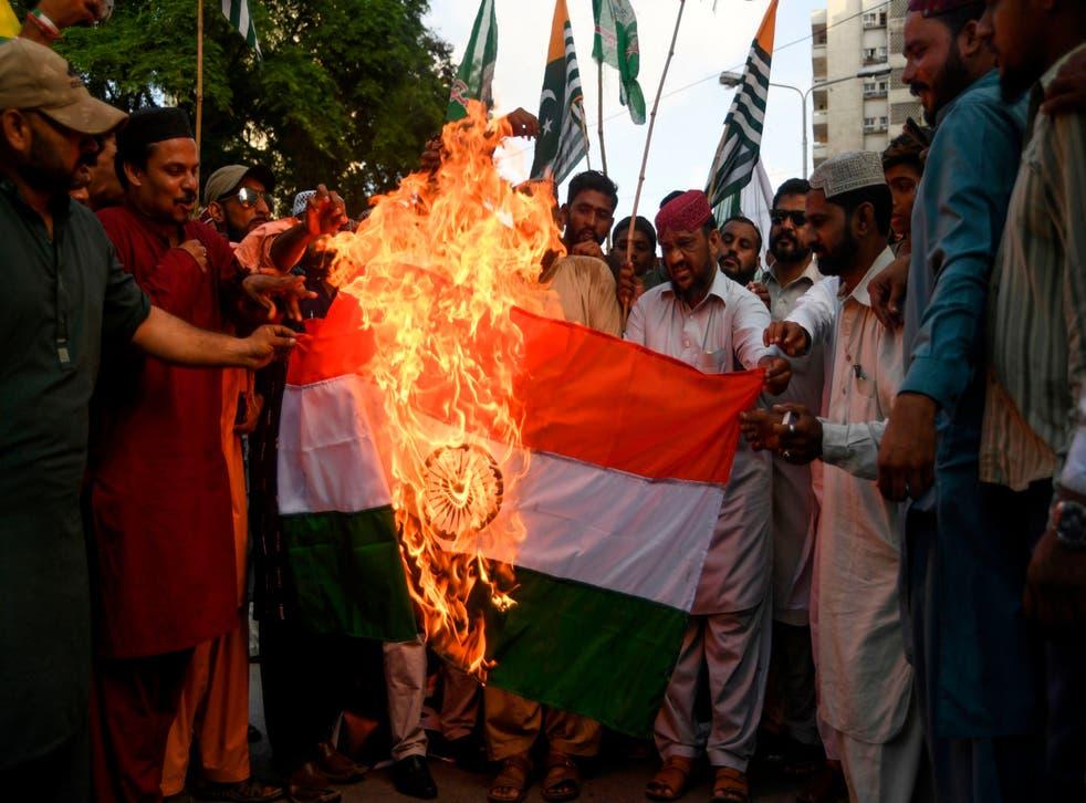 Demonstrators burn an Indian flag during a protest in Karachi