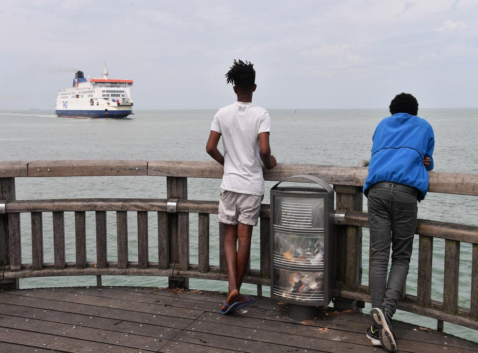 Eritrean migrants observe a ferry arriving in the French port from the UK this month
