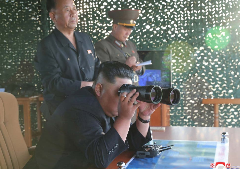 North Korean leader 'oversees test of super-large multiple