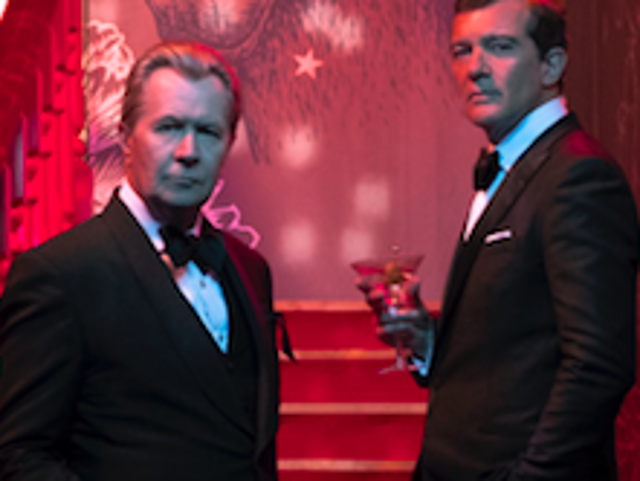 Gary Oldman and Antonio Banderas, dressed like ageing lounge lizards, play Mossack and Fonseca