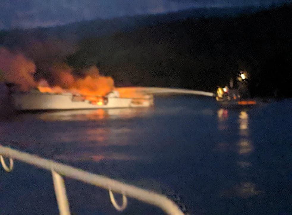 Firefighters try to put out the blaze on the diving boat Conception after it caught fire off Santa Cruz Island