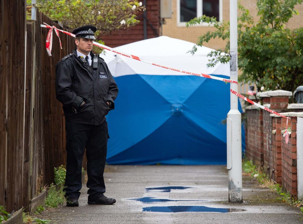 Police at the scene in Byford Close, Stratford, where detectives have launched a murder investigation