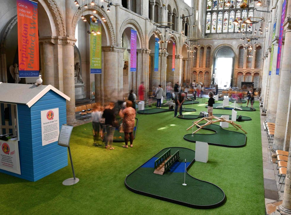 Rochester Cathedral installed a miniature golf course in its nave to improve visitor numbers this summer
