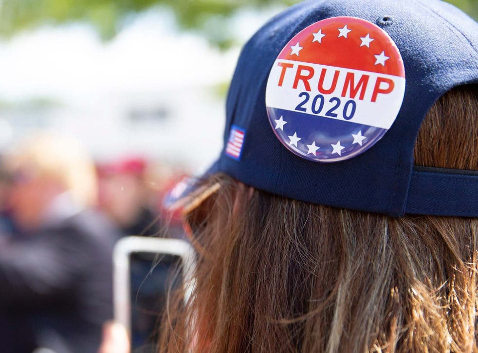 A woman prepares for a Trump rally in New Hampshire, which the president lost by less than half a point.