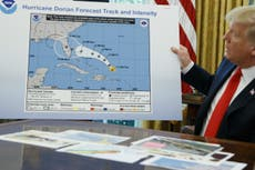 Trump shows 'doctored map' to seek to back false claim about Dorian