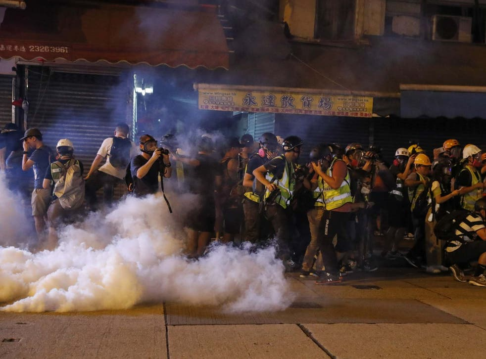 Riot police fire tear gas to disperse protesters attending a rally in Mong Kok, Hong Kong, China, 6 September 2019.