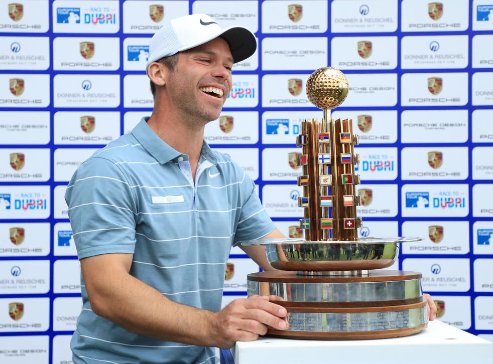 Paul Casey celebrates with the trophy after victory at the Green Eagle Golf Course