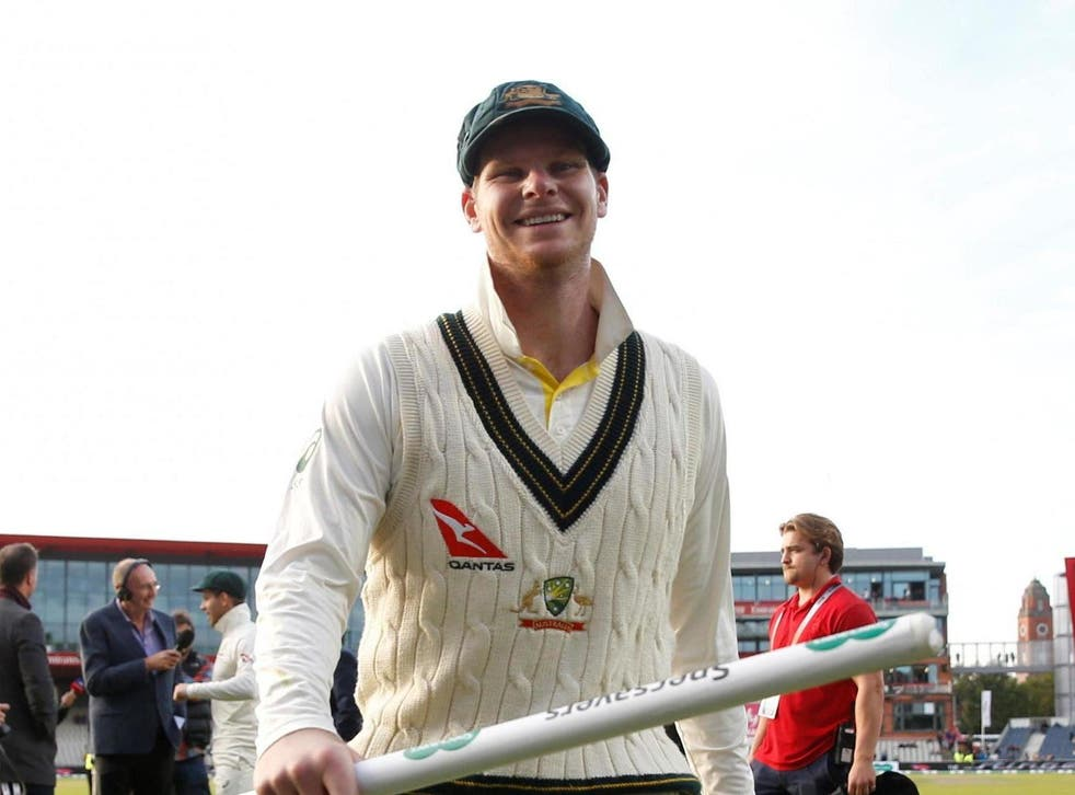 Steve Smith celebrates at Old Trafford after Australia retain the Ashes